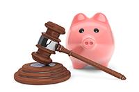 Judicial Gavel And Piggy Bank
