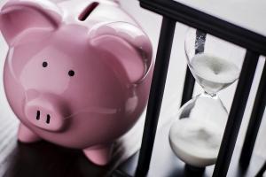 Piggy Bank With An Hour Glass